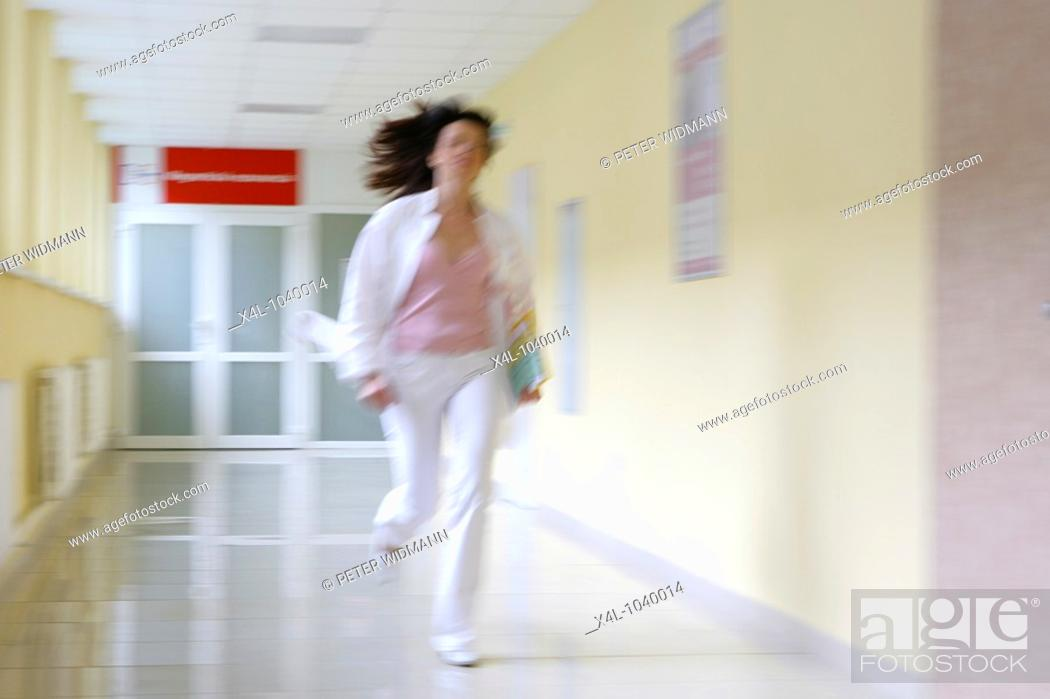 Stock Photo: female doctor running in hospital corridor.