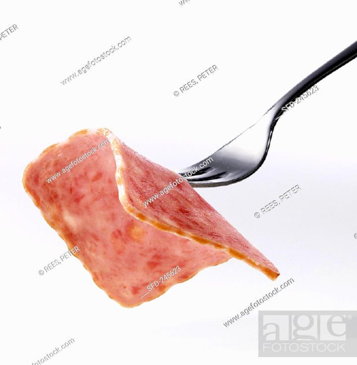 Stock Photo: Slice of Jagdwurst (hunter's sausage) on fork.