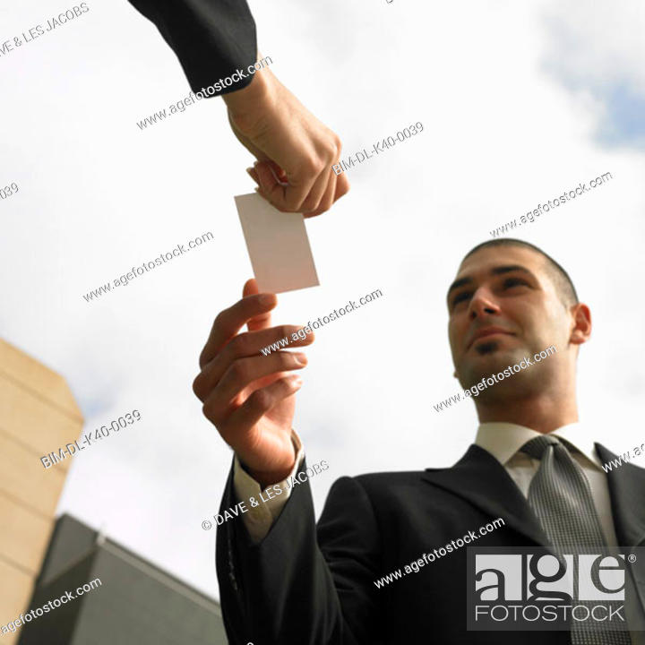 Stock Photo: Businesspeople exchanging business cards.