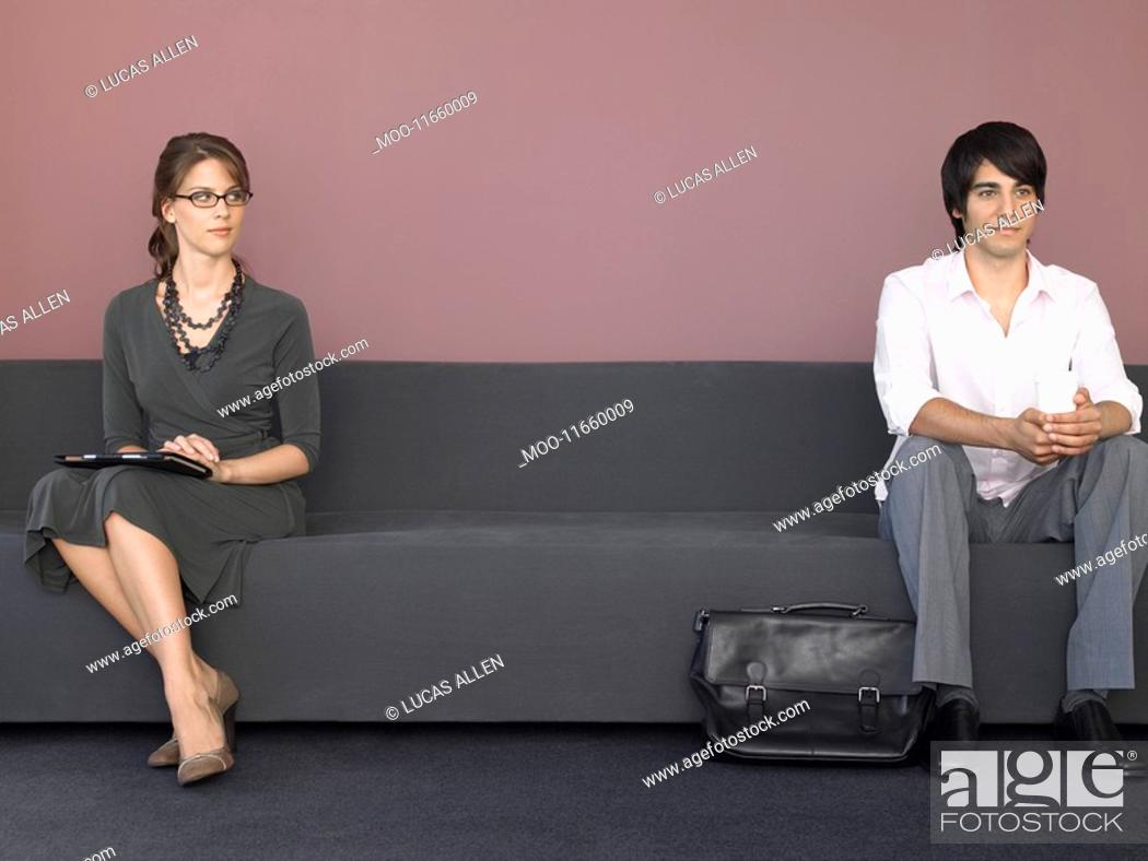 Stock Photo: Business man and woman sitting on sofa.