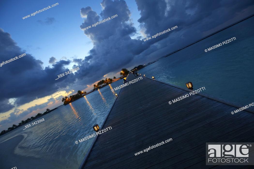 Stock Photo: Footbridge of Paradise Island (Lankanfinolhu) at dusk, Maldives.