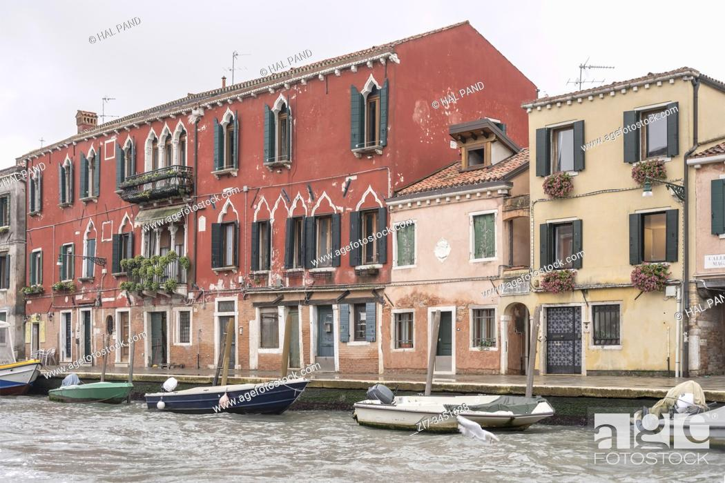 Stock Photo: traditional historical houses on canal embankment, shot in bright fall light at Venice, Veneto, Italy.
