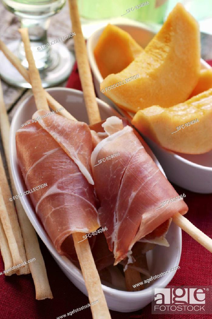 Stock Photo: Parma ham with grissini, melon.