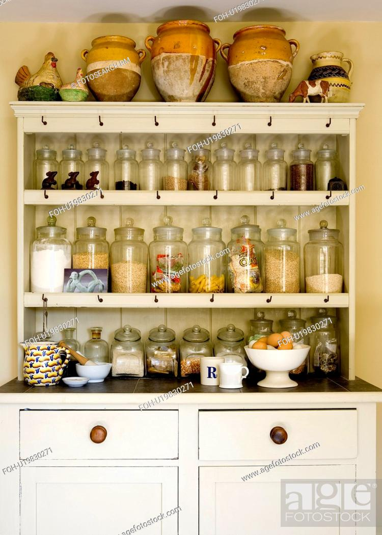 Provencal Pots And Rows Of Glass Kitchen Storage Jars On Shelves Of Victorian Dresser Stock Photo Picture And Rights Managed Image Pic Foh U19830271 Agefotostock