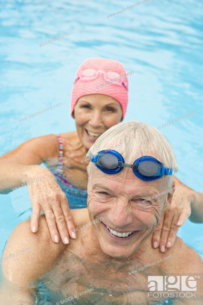 Photo de stock: Germany, Senior couple in swimming pool.