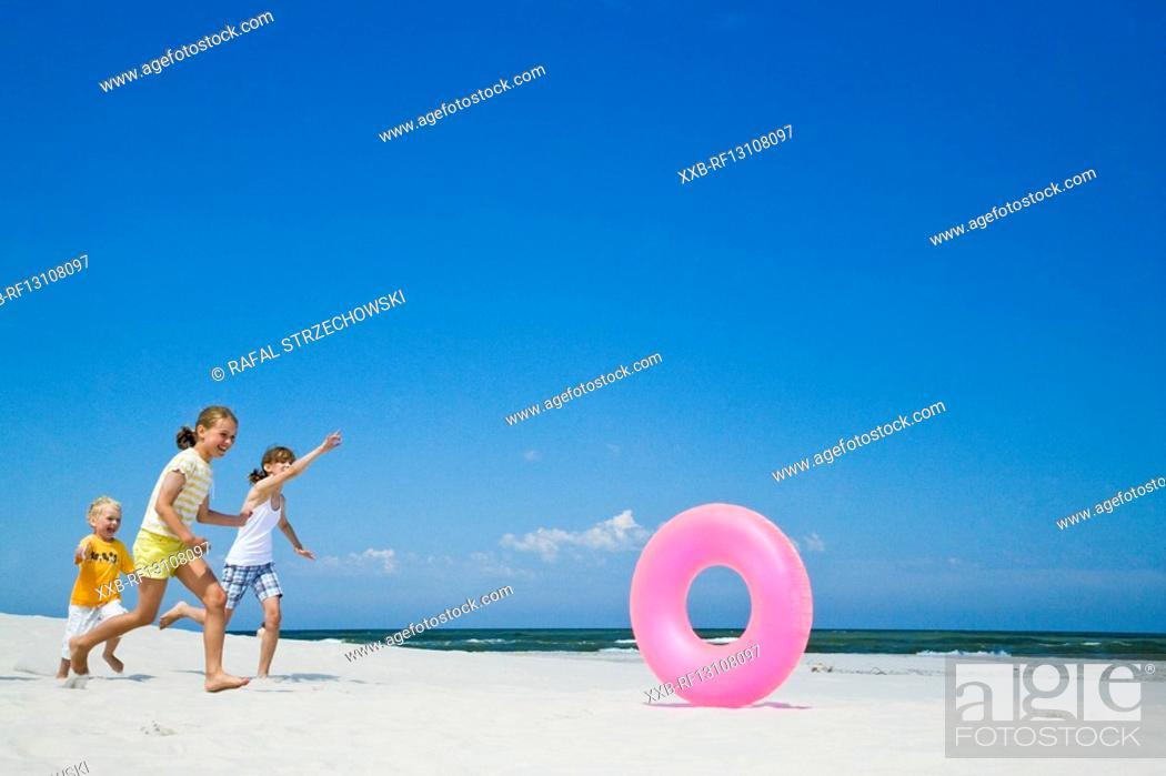 Stock Photo: children playing on beach.