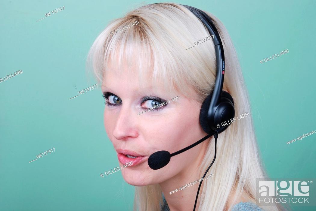 Stock Photo: Portrait of young woman with headset.