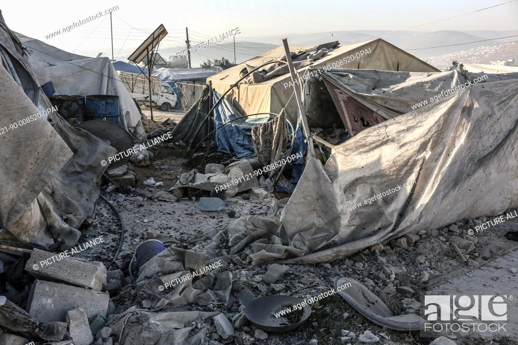 Stock Photo: 21 November 2019, Syria, Qah: A general view of damaged tents after a rocket attack that was allegedly carried out by the Syrian government forces the night.