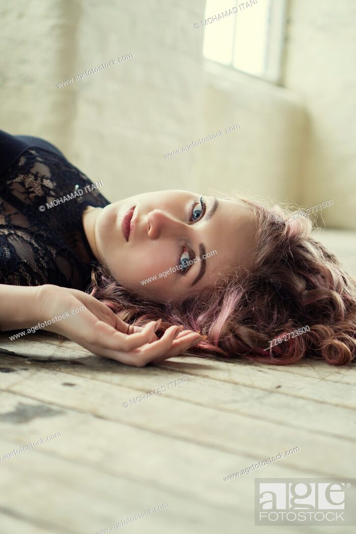 Stock Photo: Portrait of a woman laying on the floor.