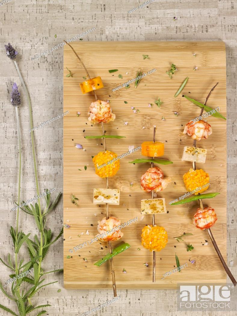 Stock Photo: pinchos de colas de gambas y verduras / skewers of prawn tails and vegetables.