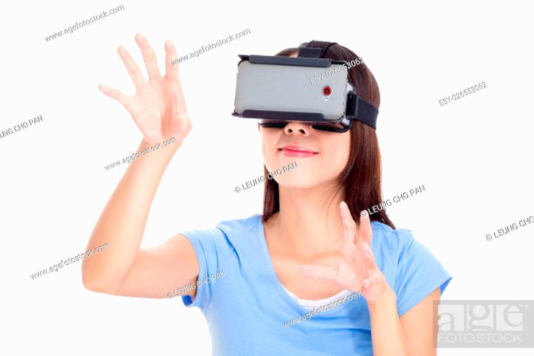 Stock Photo: Woman watching with virtual reality device.
