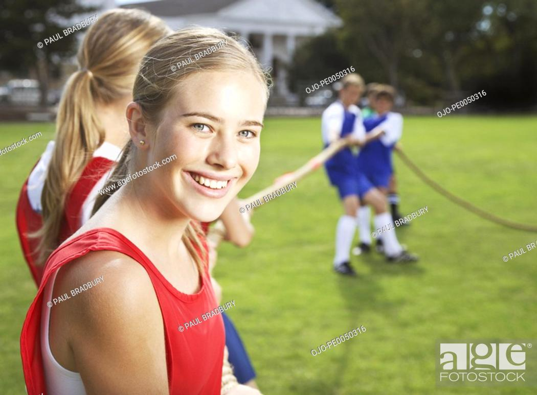 Stock Photo: Kids playing tug of war.