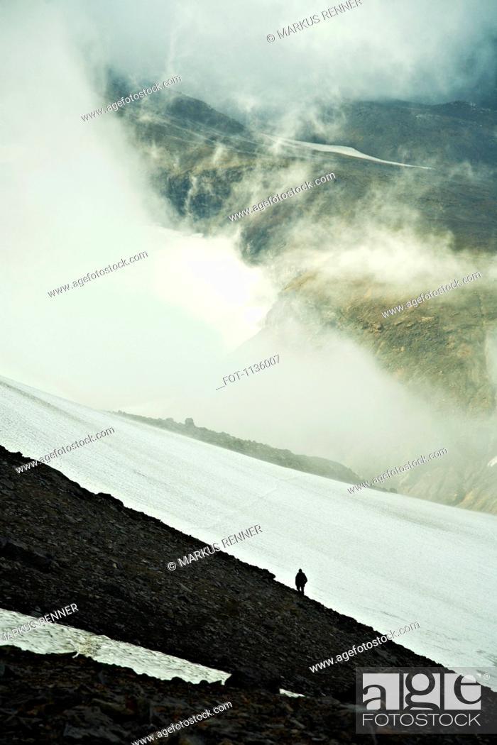 Stock Photo: A lone hiker walking along the Mutnovsky Volcano, Kamchatka, Russia.