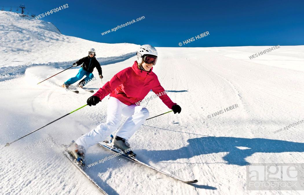 Stock Photo: Austria, Salzburg, Young couple skiing on mountain.