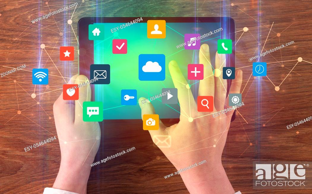 Stock Photo: Hand touching multitask tablet with cloud wifi message social media call icons and symbols concept.