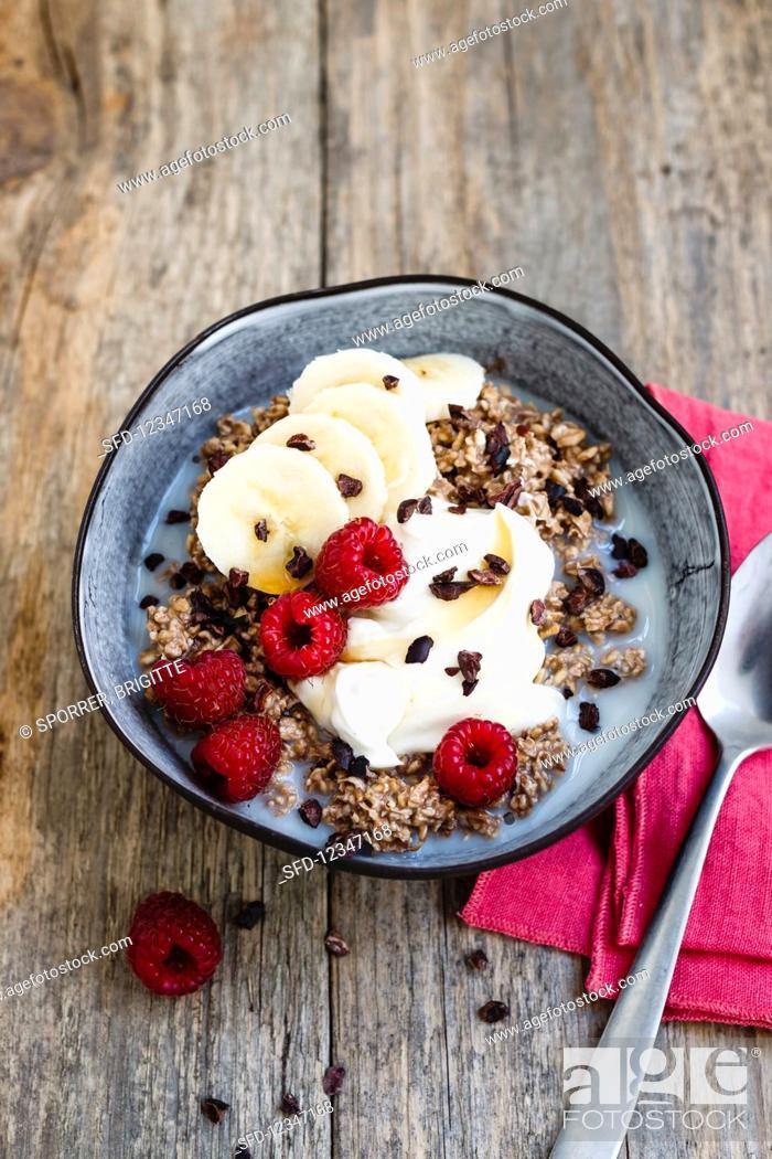 Stock Photo: Overnight oats with chocolate, banana and raspberries.