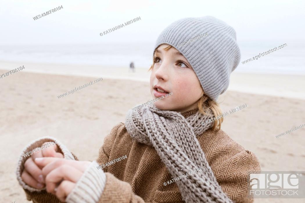 Stock Photo: Portrait of boy on the beach in winter.
