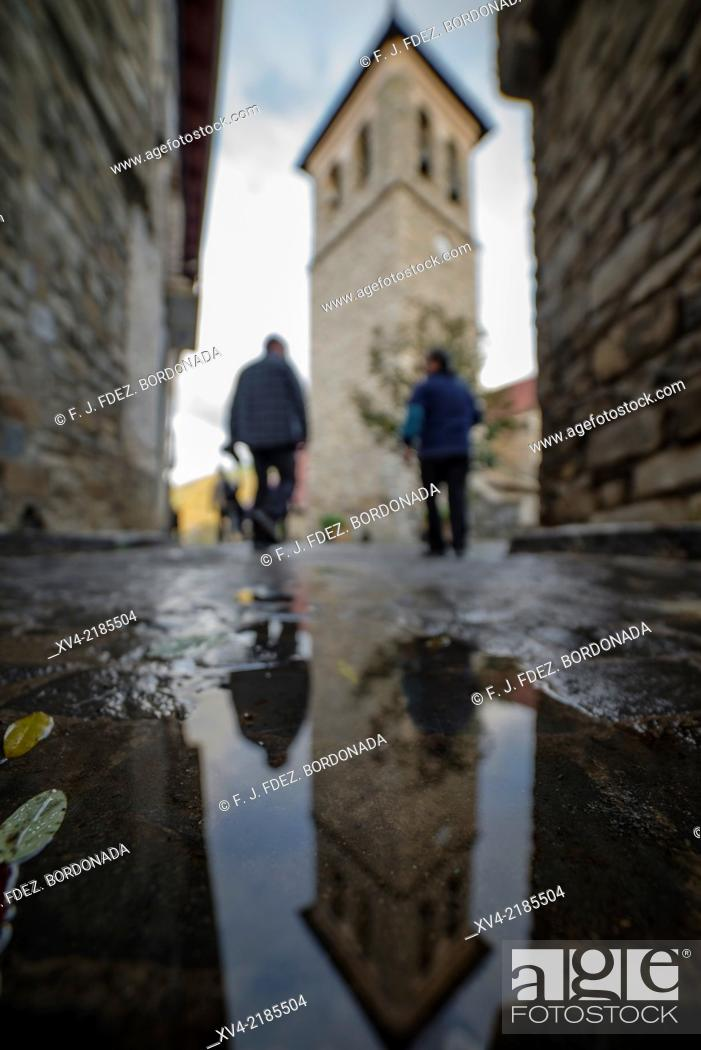 Stock Photo: People Silhouettes and Stone architecture of houses and narrow streets in Aragues del Puerto village, Huesca Pyrenees, Aragón, Spain.