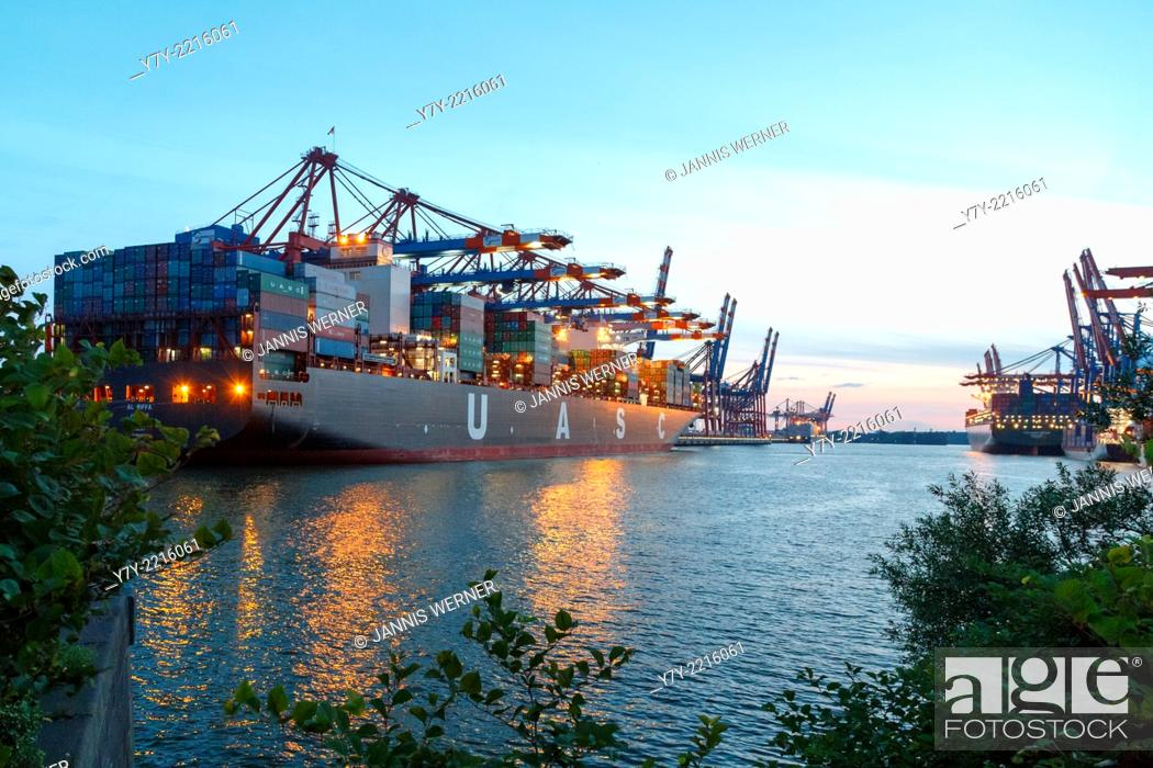 Stock Photo: Ships moored at the Eurogate and Burchardkai container terminals in the port of Hamburg, Germany, at sunset in summer.