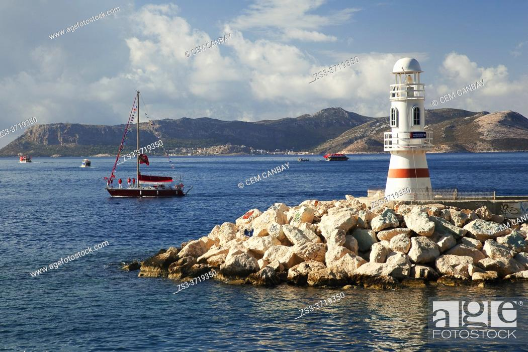 Imagen: Boats near the lighthouse of Kas with the sailboats at the background during the celebrations of the Independence day of Turkey at 29 October, Kas.