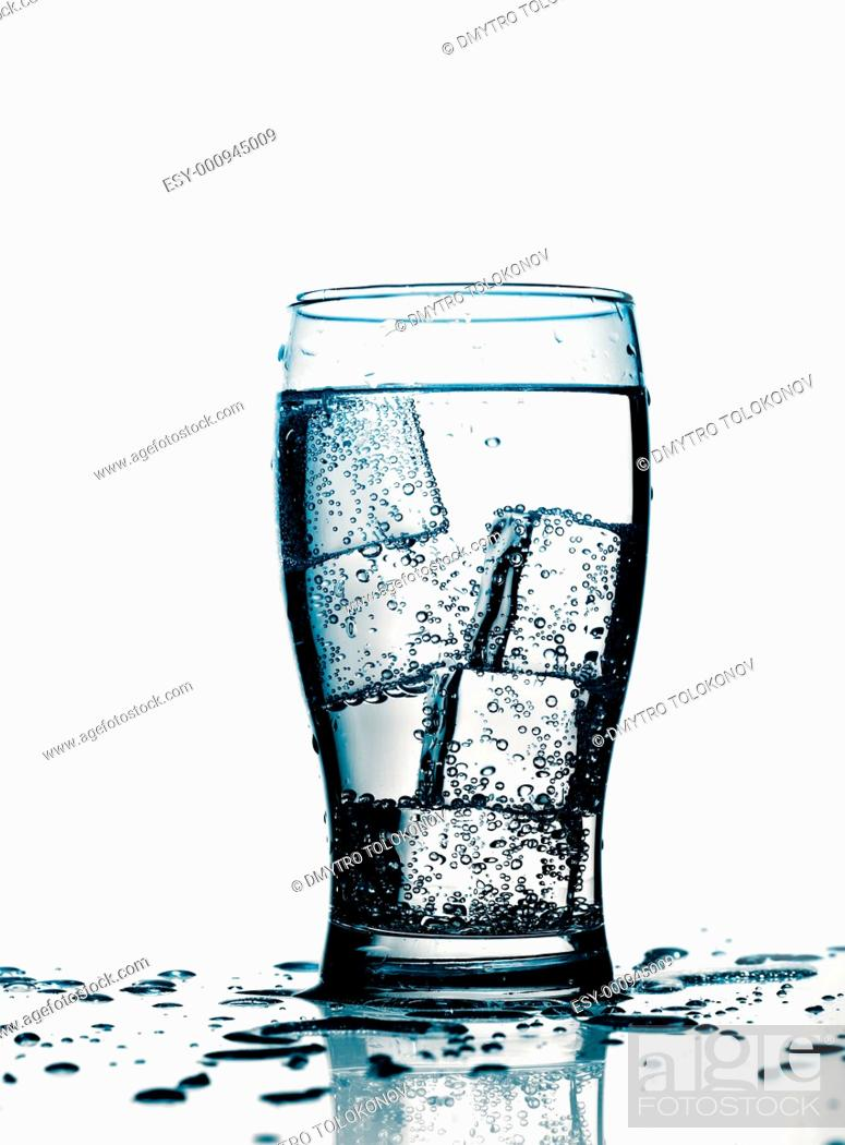 Stock Photo: glass with cold purified water and ice, over white background.