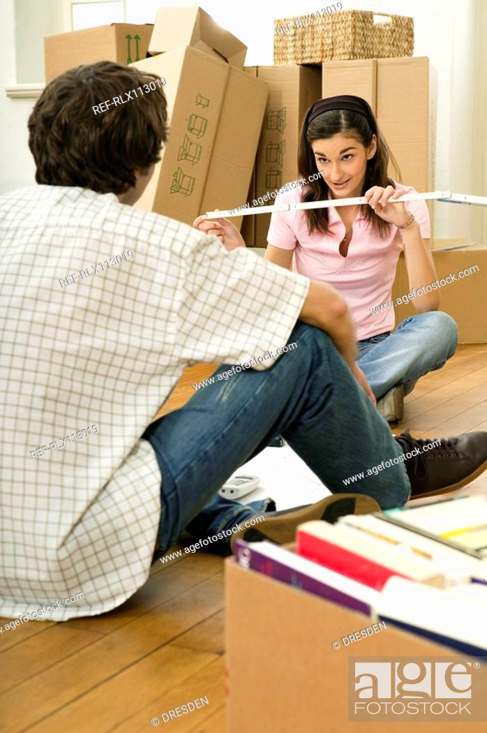 Stock Photo: Couple planning home improvements.