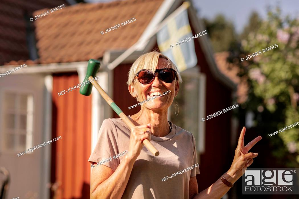 Stock Photo: Happy woman holding croquet mallet.