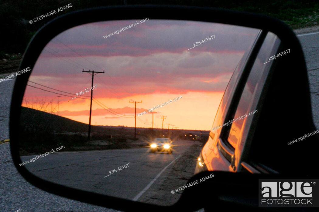 Stock Photo: sunset reflection in car mirror.