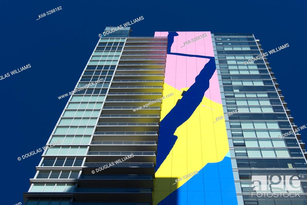 Stock Photo: The Charleson, apartment tower in downtown Vancouver, BC, Canada, with a 416 foot high mural named Finger Paint by artist Elizabeth McIntosh.