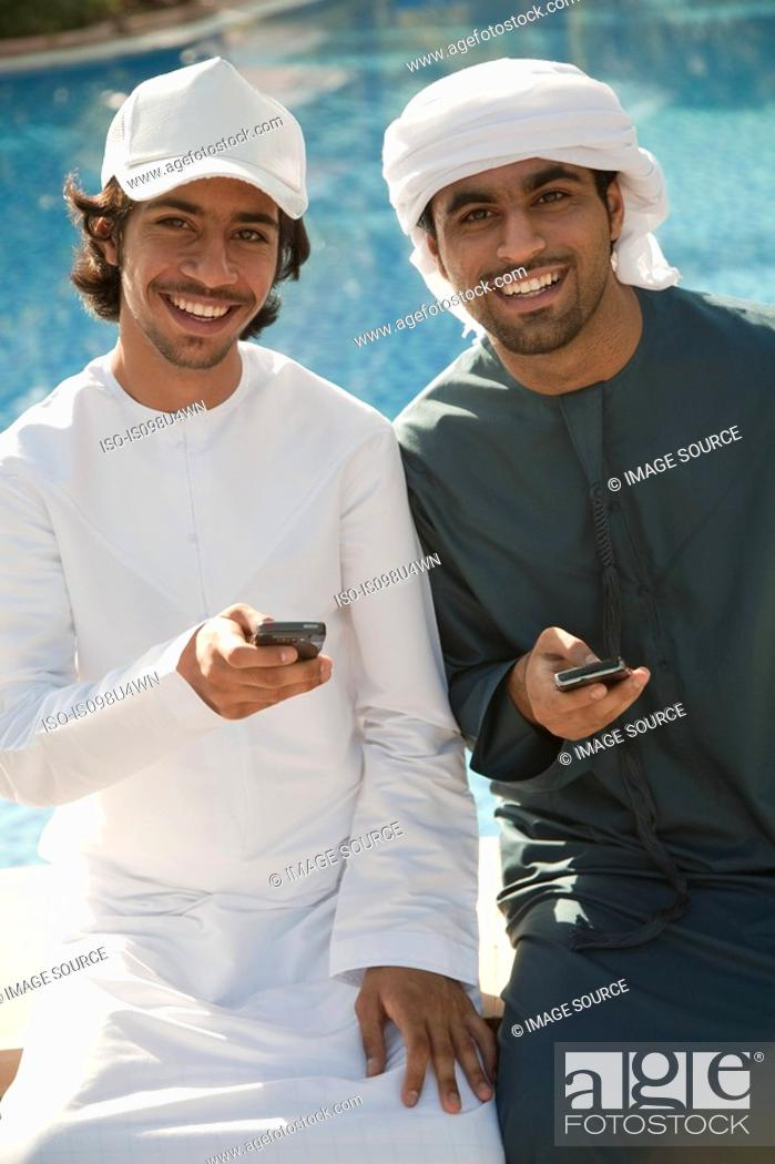 Stock Photo: Two Middle Eastern men with mobile phones.