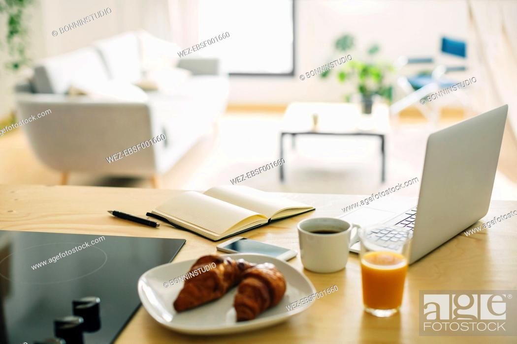 Stock Photo: Home office and breakfast on the kitchen counter.