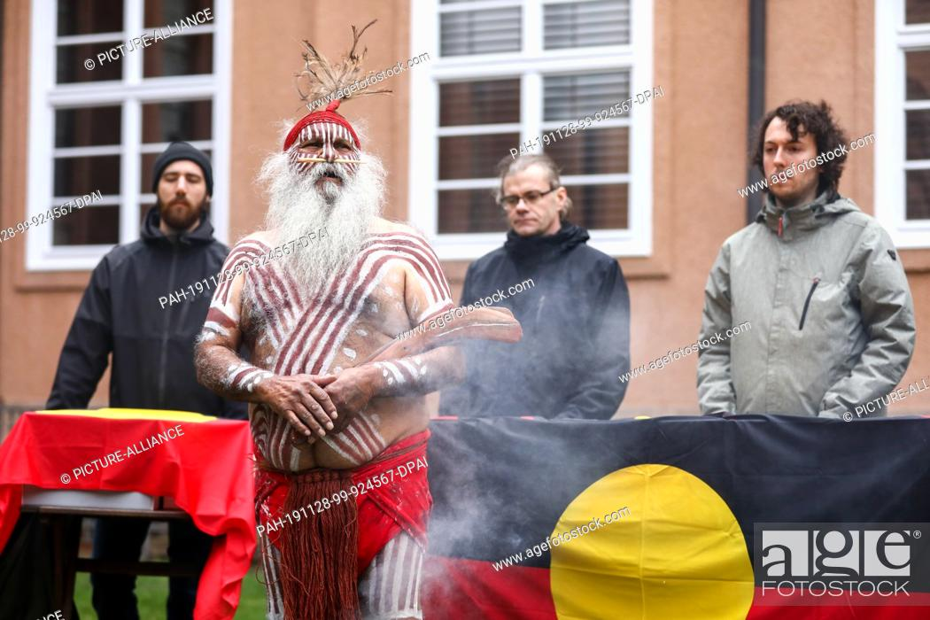 Stock Photo: 28 November 2019, Saxony, Leipzig: Major Sumner, representative of the Australian Ngarrindejeri Community, conducts a smoking ceremony in the courtyard of the.