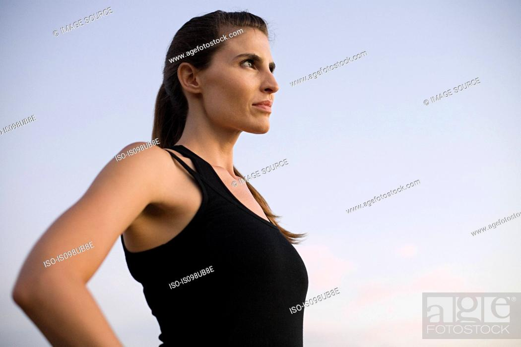Stock Photo: Young woman looking away.