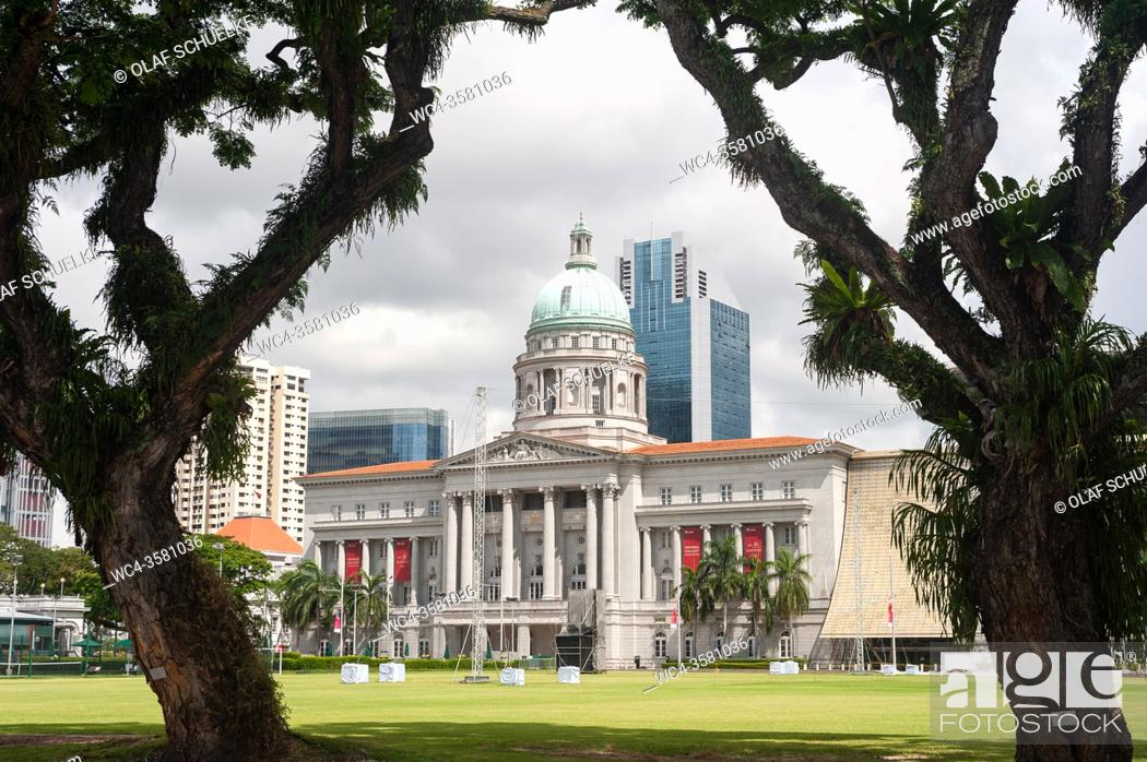 Stock Photo: Singapore, Republic of Singapore, Asia - View across the Padang playing field towards the National Gallery Singapore, formerly the Supreme Court and City Hall.