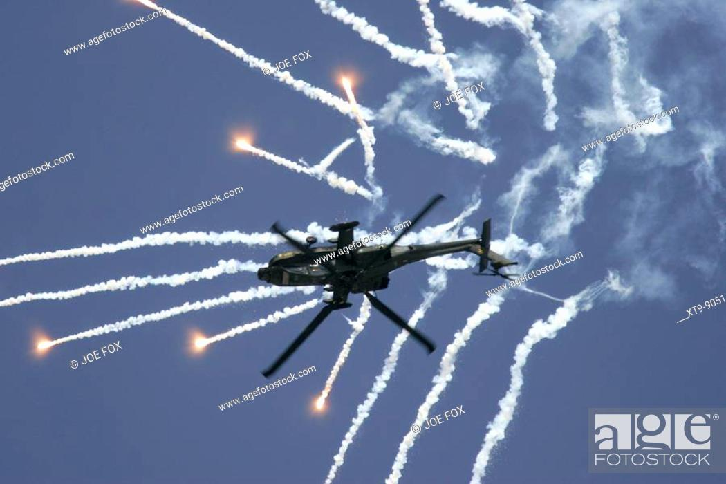 Stock Photo: Royal Netherlands Air Force Apache AH-64D firing decoy flares RIAT 2005 RAF Fairford Gloucestershire England UK.