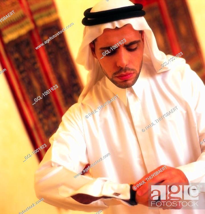 Stock Photo: Arab man checking the time.