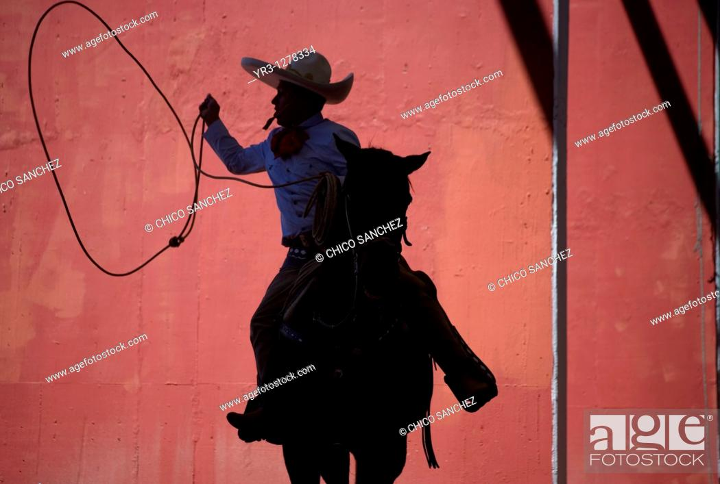 Stock Photo: A Mexican charro practices his lasso at the National Charro Championship in Pachuca, Hidalgo State, Mexico. Escaramuzas are similar to US rodeos.