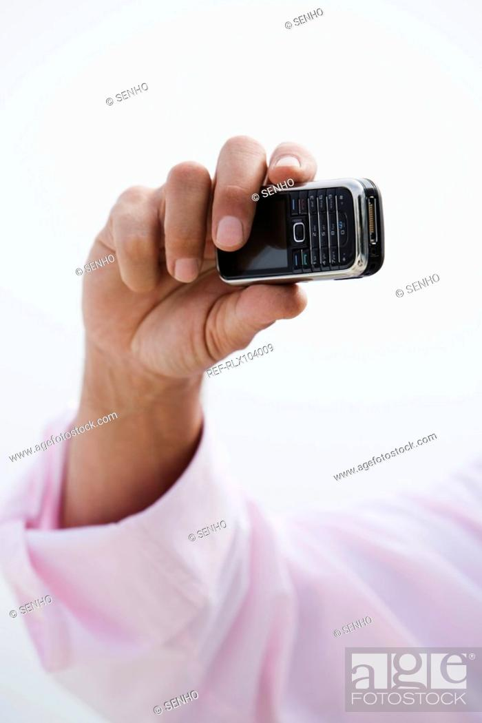 Stock Photo: Hand holding camera phone, taking photo.