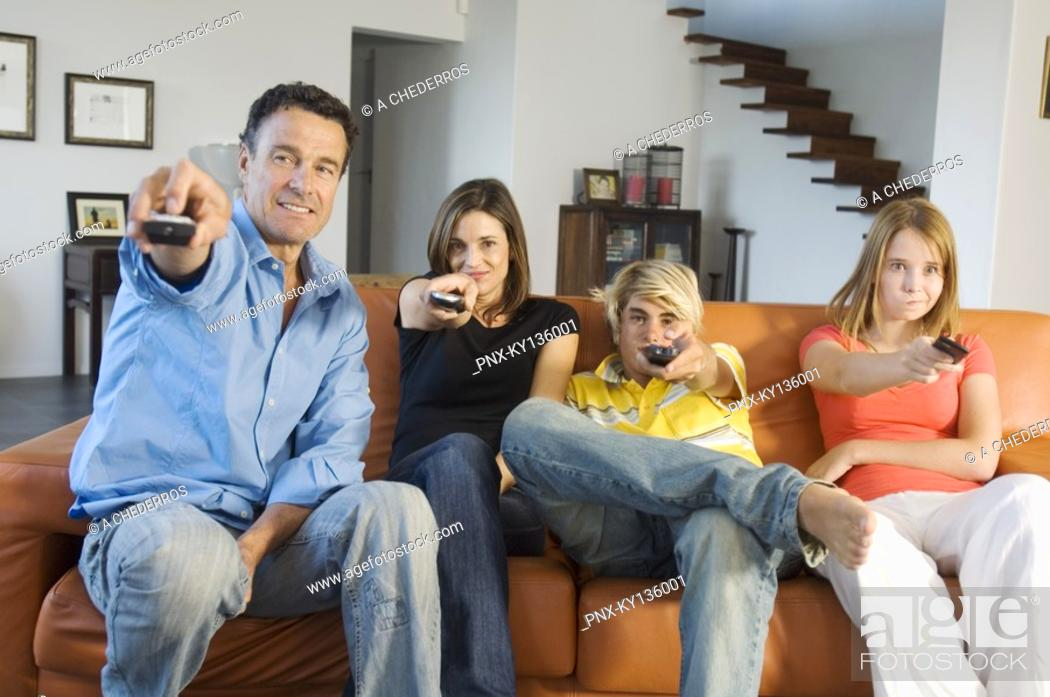 Stock Photo: Family watching television, indoors.