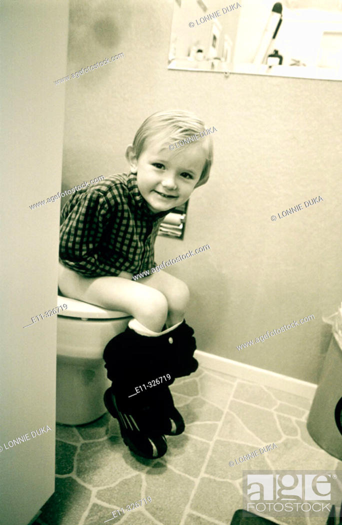 Stock Photo: 4 years old boy sitting on potty.