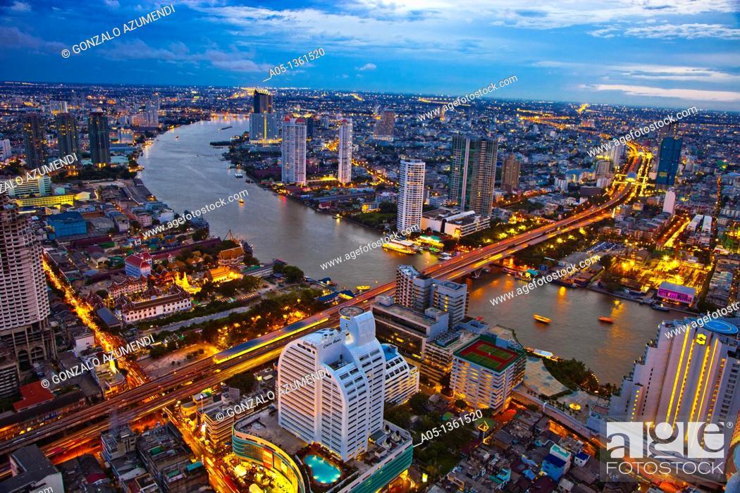 Stock Photo: City Skyline and Chao Phraya River  Bangkok  Thailand.