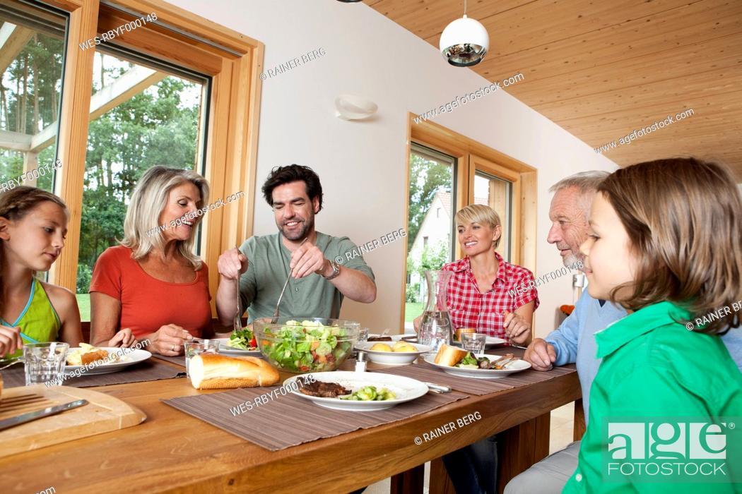 Stock Photo: Germany, Bavaria, Nuremberg, Family having lunch together.