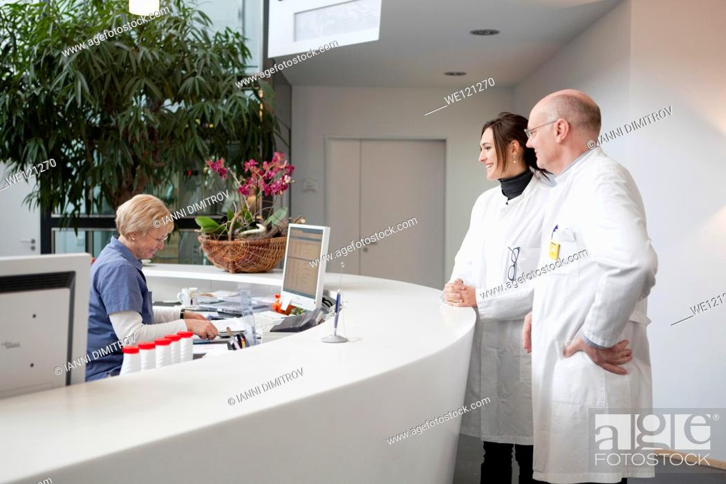 Stock Photo: Doctors at the reception of modern hospital.