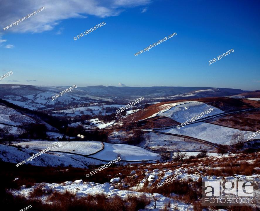 Stock Photo: View westwards over snow covered moorland landscape and fields towards Peak District village from Higgartor.
