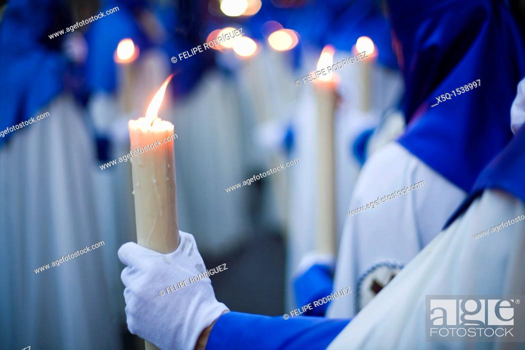 Stock Photo: Penitents bearing candles, Holy Week 2008, Seville, Spain.