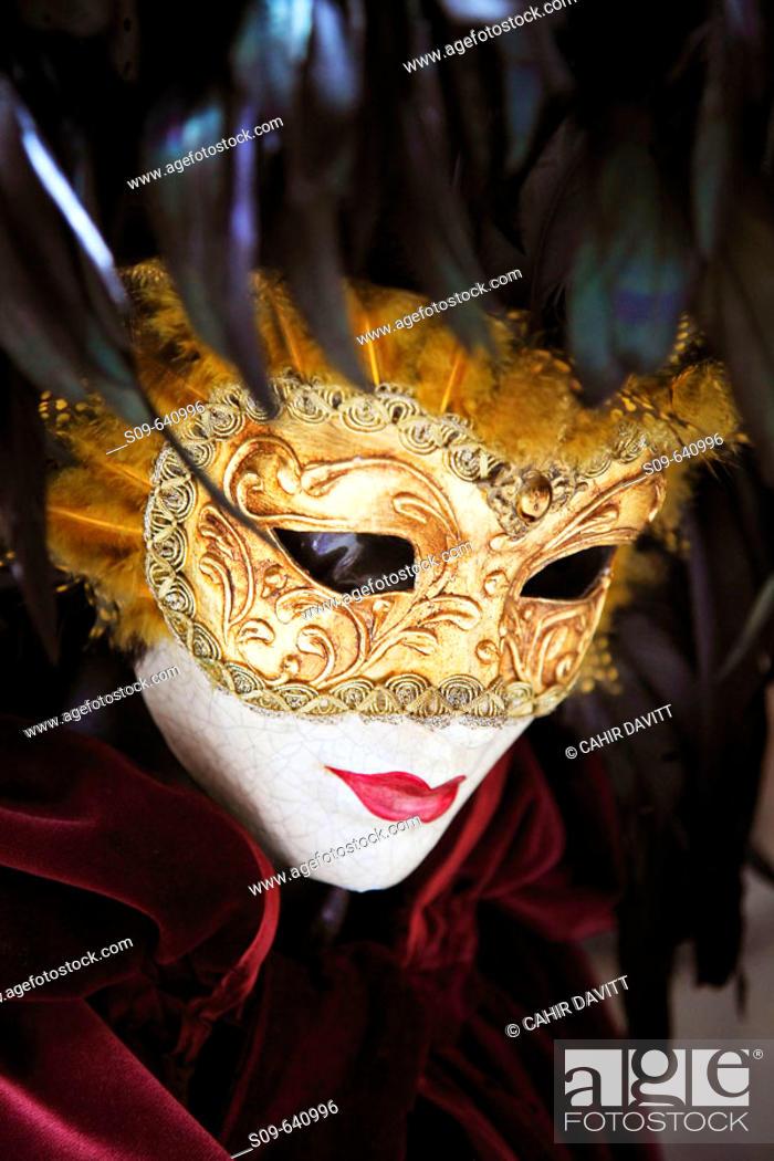 Stock Photo: Venetian carnival mask display in a specialist shop near Rialto, San Polo, Venice, Veneto, Italy.