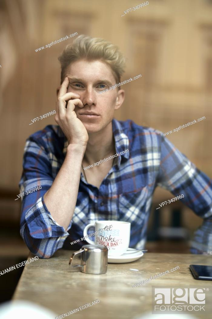 Stock Photo: Young man in cafe, Munich, Germany.