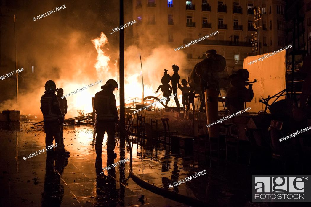 "Stock Photo: Firefighters at work during the night of """"La Crema"""" the burning at the Valencian town hall square as part of the last day of las Fallas festival in Spain."