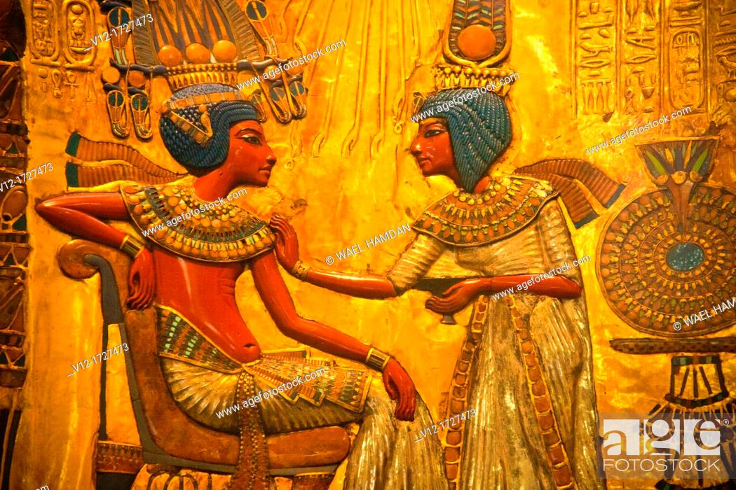 Stock Photo: The queen ankhesenamen anointing her husband Tutankhamen beneath the life-giving rays of the sun disc, Chair Discovered in the valley of the kings , Egypt.