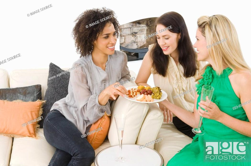 Stock Photo: A woman offering friends canapes.